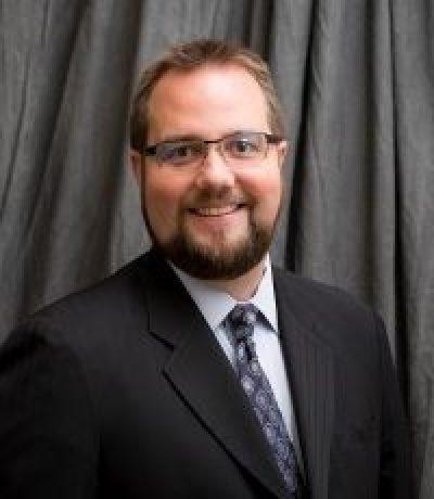 Joshua E. Karoly